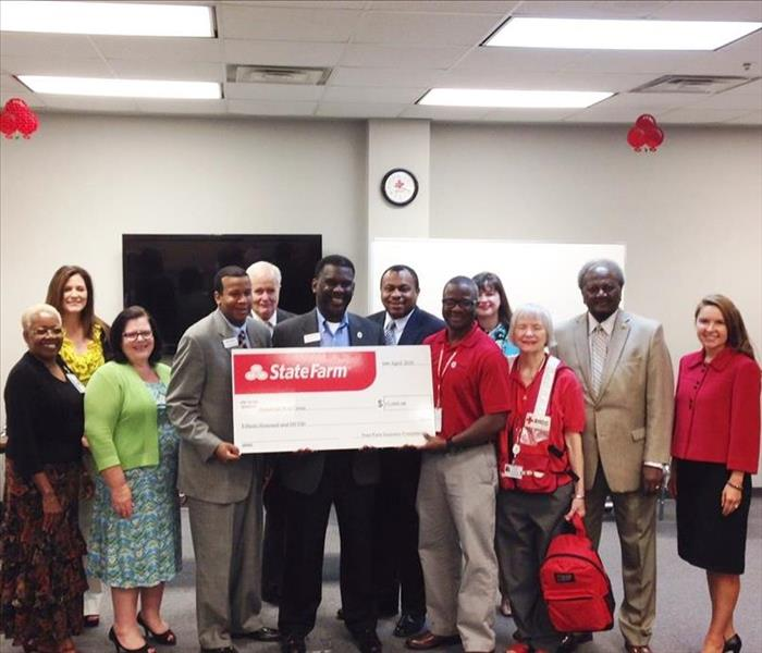 The American Red Cross Receives a Donation on State Farm Day